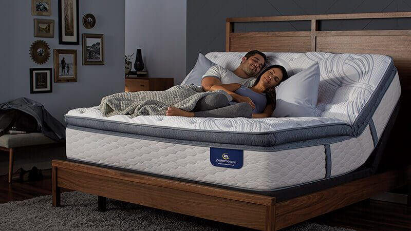 couple sleeping on adjusted perfect sleeper