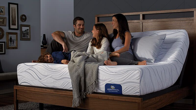 family sitting on perfect sleeper memory foam mattress